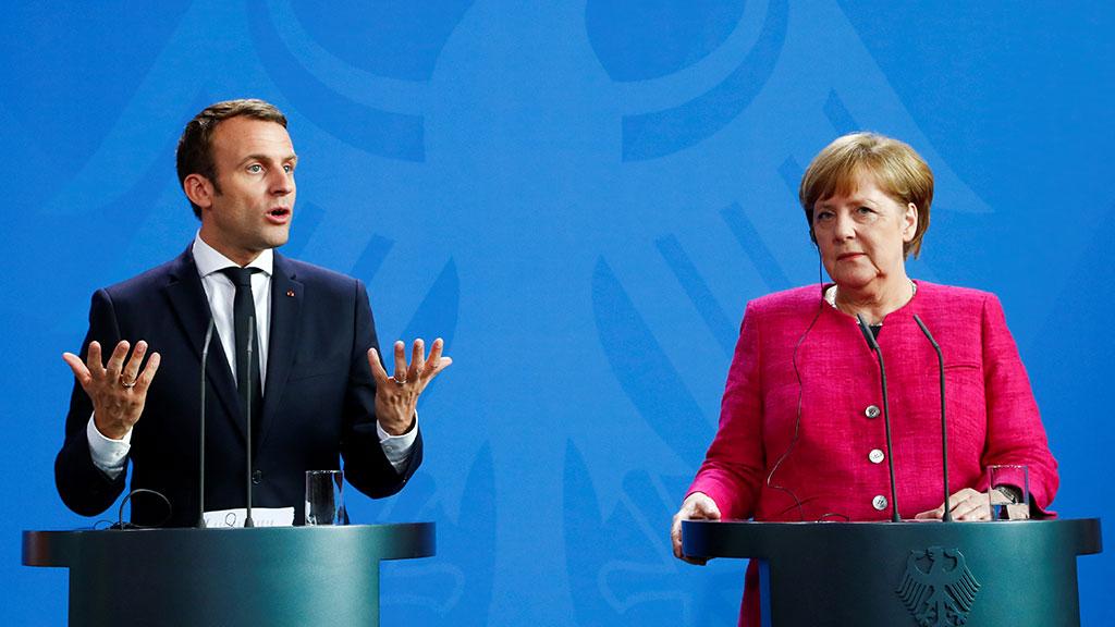Меркель і Макрон закликали Росію повернути своїх військових вСЦКК наДонбасі